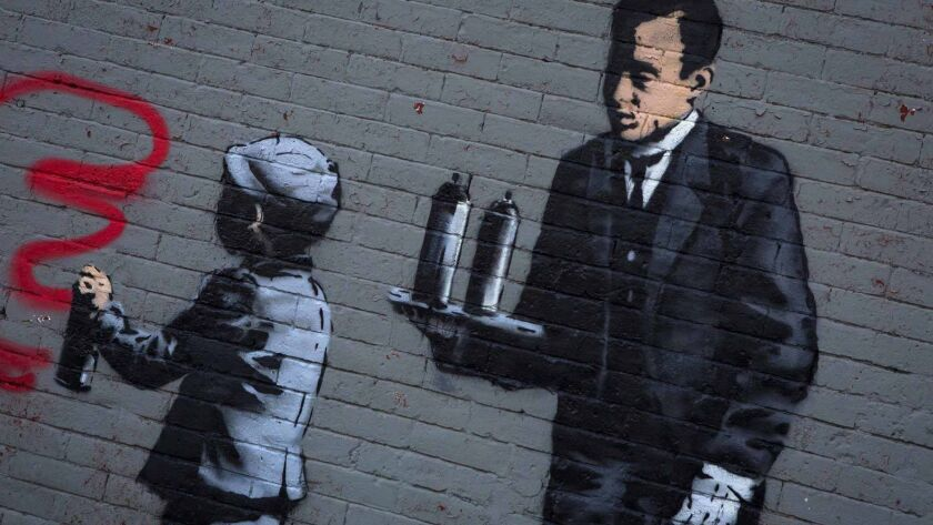 An installation by British graffiti artist Banksy is seen in the Bronx section of New York October 21, 2013.