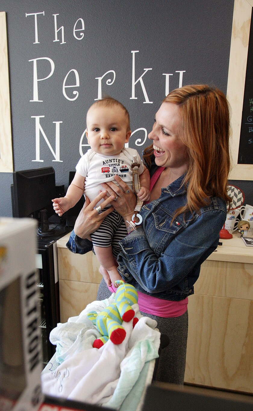 Store owner Tiffany Melius with her 8-month-old son Jack
