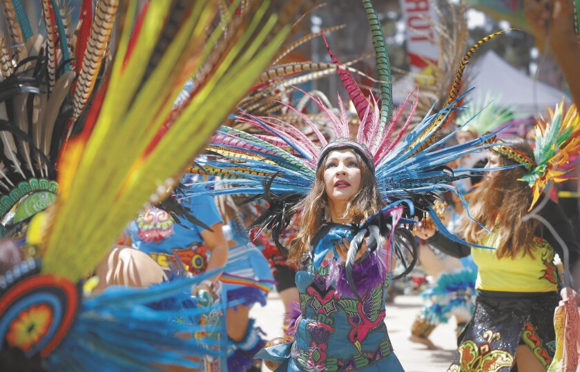 Aztec dancers from numerous groups in The United States and Mexico perform at a previous Chicano Park Day celebration.