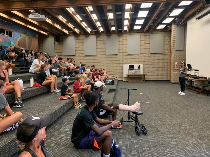 Tara Butcher speaking to students at Torrey Pines High School July 12.