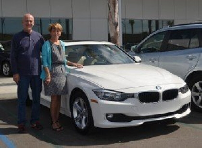 Raffle winner Sharon Bell with her new BMW 320i.