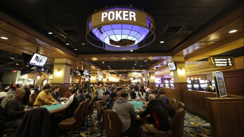 In this Wednesday, Feb. 3, 2016 photo patrons play poker in a designated area at Twin River Casino,