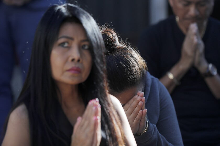 Sithy Yi prays at the Buddhist cleansing ceremony in Long Beach