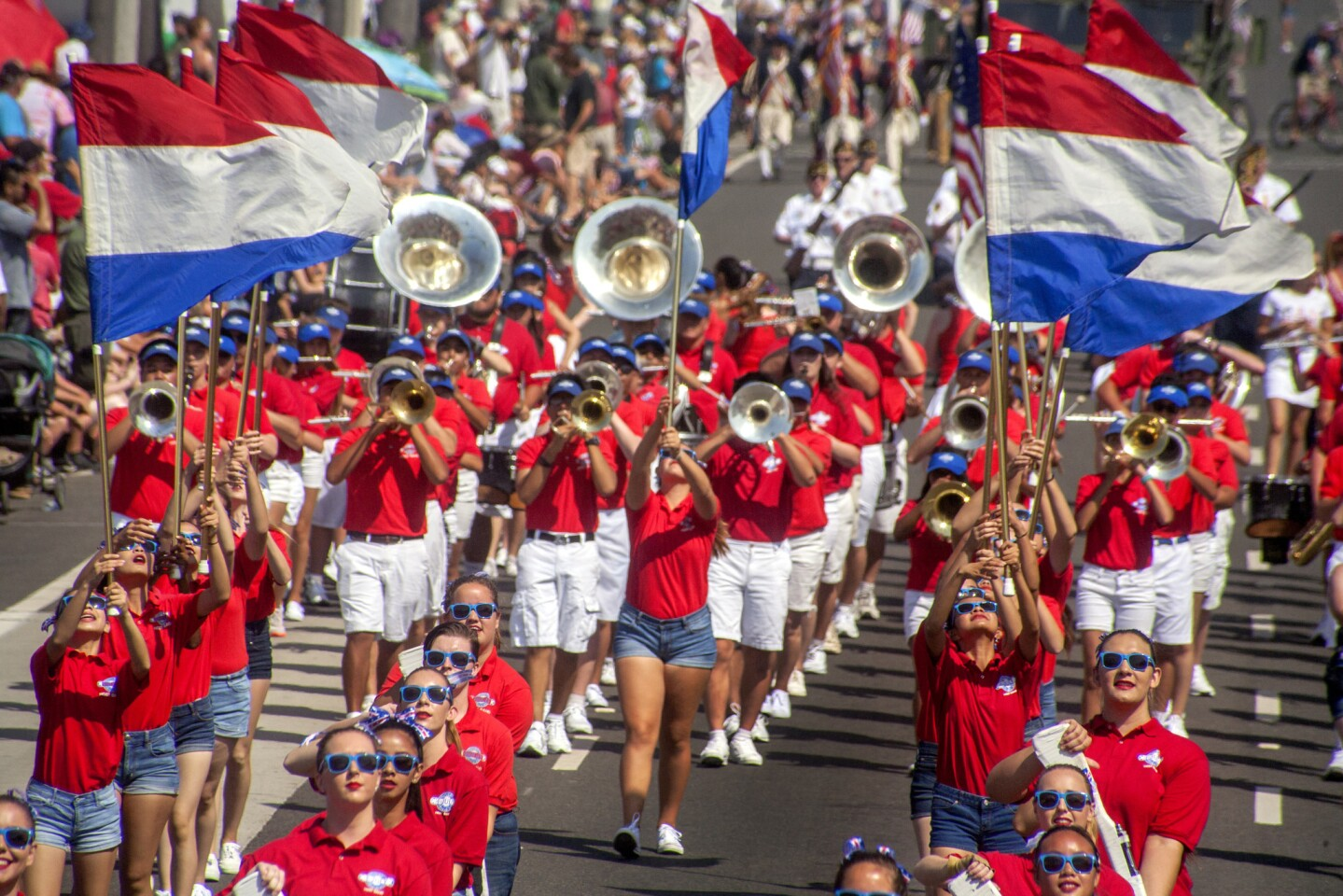 Banners fly over the Huntington Beach Union High School District Host Band at the annual Fourth of July Parade.