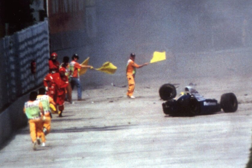FILE - In this May 1, 1994, file photo, Race officials run toward Brazil's Aytron Senna after he crashed with his Williams-Renault during the San Marino F-1 Grand Prix in Imola. Senna died at a Bologna hospital later. Nearly three years after the fatal crash, six top Formula One figures, including Frank Williams, head of the successful Williams-Renault team, face manslaughter carges in a trial starting in Imola Thursday, February 20, 1997. (AP Photo/file)