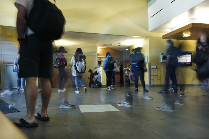 Students walk inside of Markstein Hall at Cal State San Marcos on April 10, 2019. Graduation rates are low for students trying to complete college in four years.