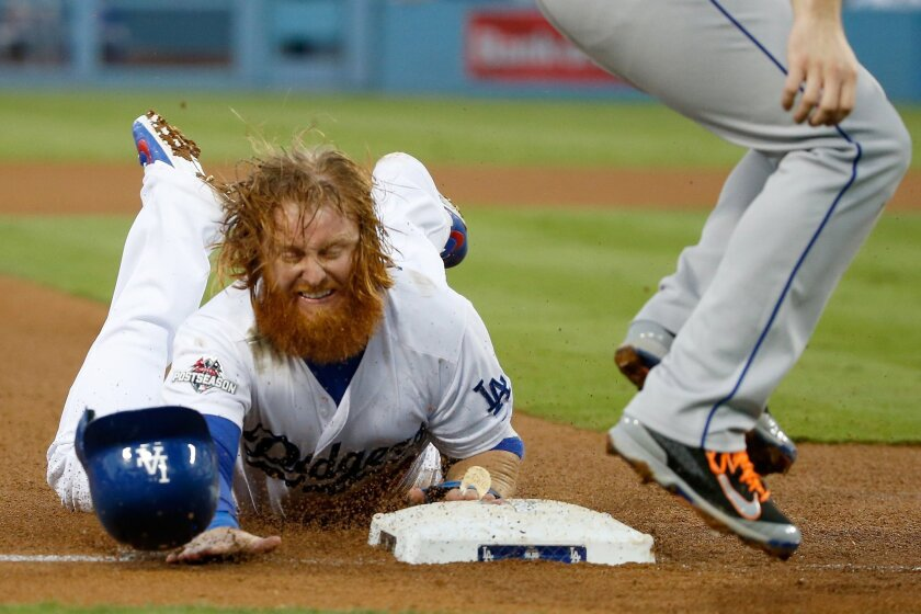 Justin Turner steals third base against the New York Mets in the third inning of game five of the National League Division Series at Dodger Stadium on Oct. 15, 2015.