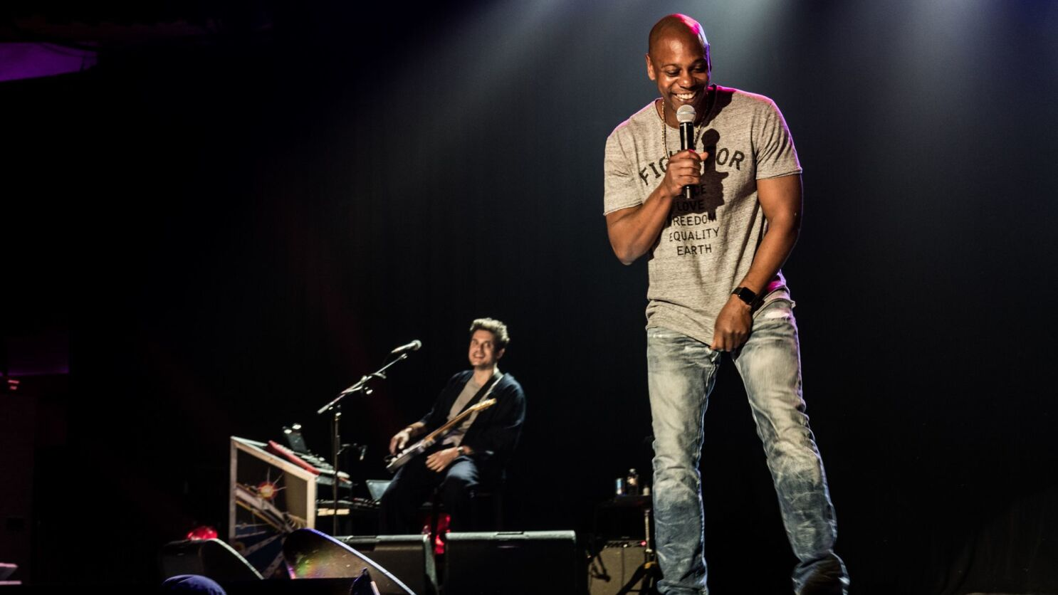 review here s what happened at dave chappelle and john mayer s secretive no phones concert los angeles times review here s what happened at dave