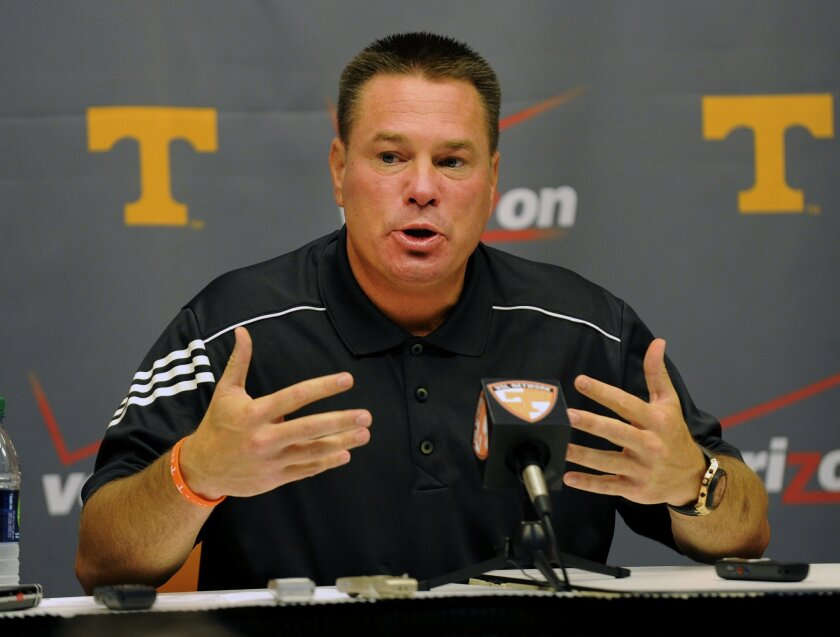 University of Tennessee NCAA college football coach Butch Jones talks about the upcoming season during a press conference Thursday, July 31, 2014, in Knoxville, Tenn. The Vols open at home Aug. 31 against Utah State. (AP Photo, Michael Patrick/Knoxville News Sentinel)