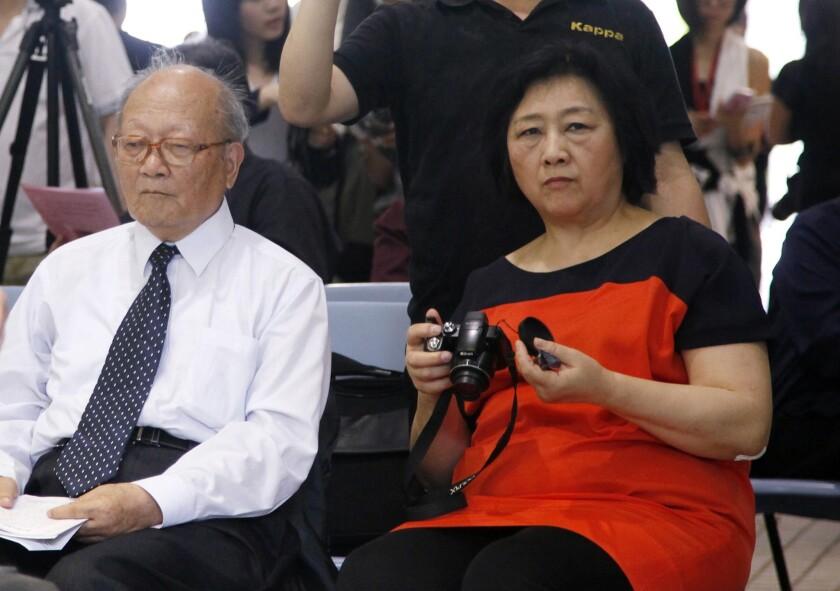 Journalist Gao Yu, right, with author Yao Jianfu at an opening of artist Liu Xia's photo exhibition in Hong Kong in June 2012.