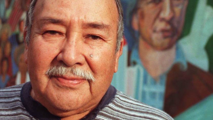 Frank Martinez with a mural he painted at San Fernando Middle School. In addition to his own work, he was known for encouraging many young artists.