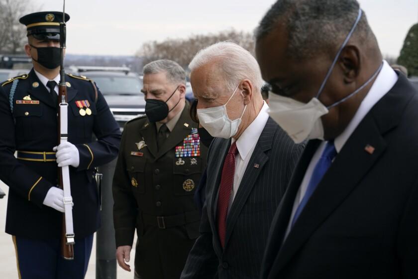 President Joe Biden walks with Joint Chiefs Chairman Gen. Mark Milley, and Defense Secretary Lloyd Austin