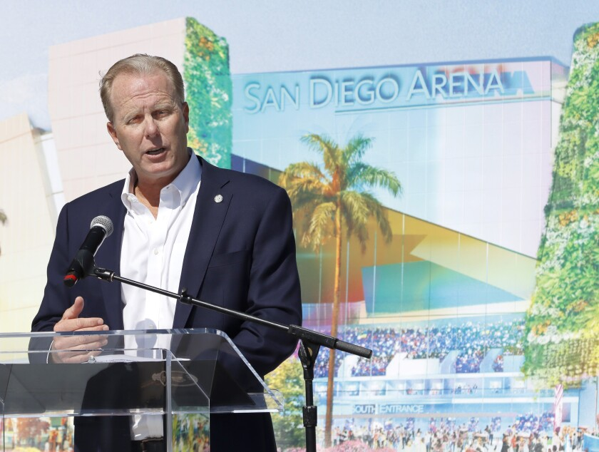 Mayor Kevin Faulconer in front of an artist's rendering of what a completely rebuilt sports arena could look like