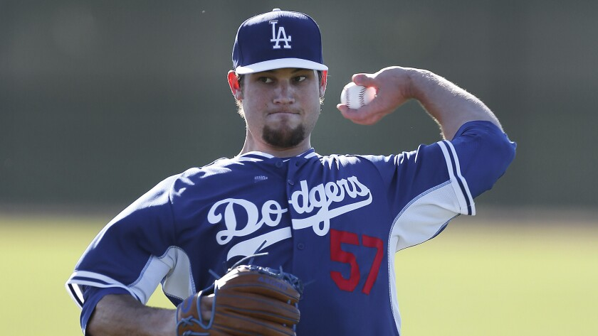 Pitcher Scott Elbert throws during a Dodgers spring training practice session on Feb. 10. Elbert has undergone three elbow surgeries in the last two years.