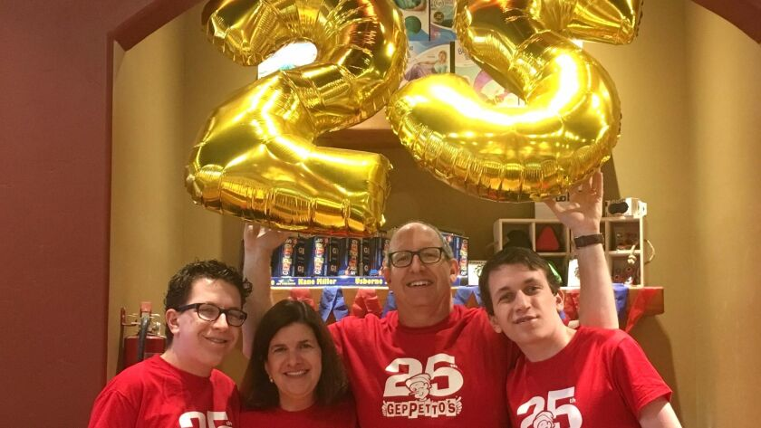 Brian Miller (second from the right), the owner of Geppetto's, celebrates the 25th birthday of buyin