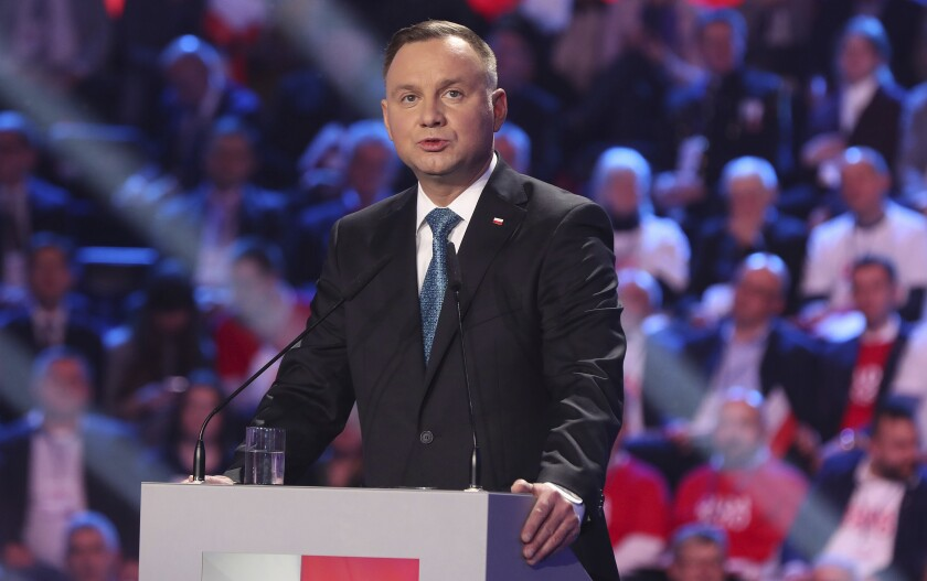 Poland's President Andrzej Duda addresses supporters during a ruling Law and Justice party convention that backed his re-election bid in the May 10 presidential vote in Warsaw, Poland, Saturday, Feb. 15, 2020. (AP Photo/Czarek Sokolowski)