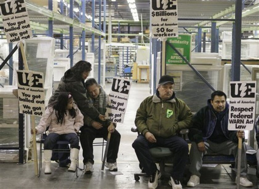 Workers and supporters line the factory floor Sunday, the third day of a sit-in at the Republic Windows and Doors factory in Chicago. The band of 200 workers is demanding severance and vacation pay. They have become a national symbol for  millions of laid off workers across the country after the co