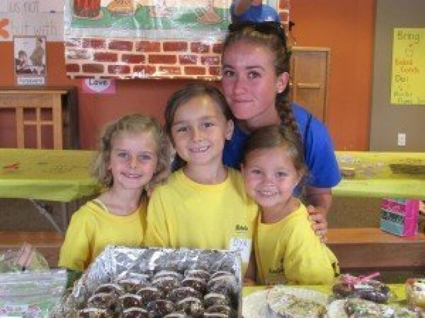 Campers and volunteers at KidsGames held a bake sale and car wash to raise money for Max's Ring of Fire, which supports pediatric cancer research and clinical trials. Photos by Kristina Houck