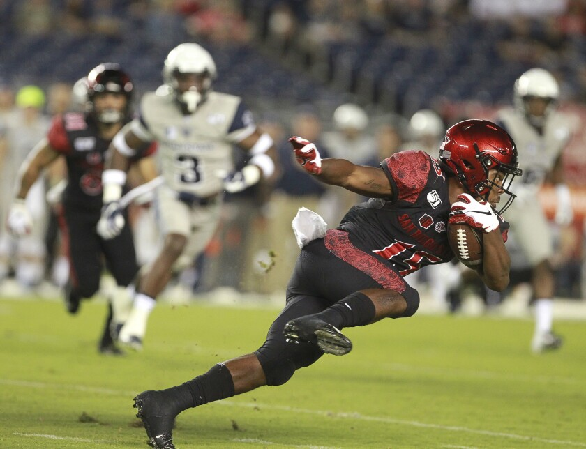 San Diego State's Jordan Byrd runs with the ball during the first quarter against Utah State at SDCCU Stadium on Saturday, Sept. 21, 2019, in San Diego.