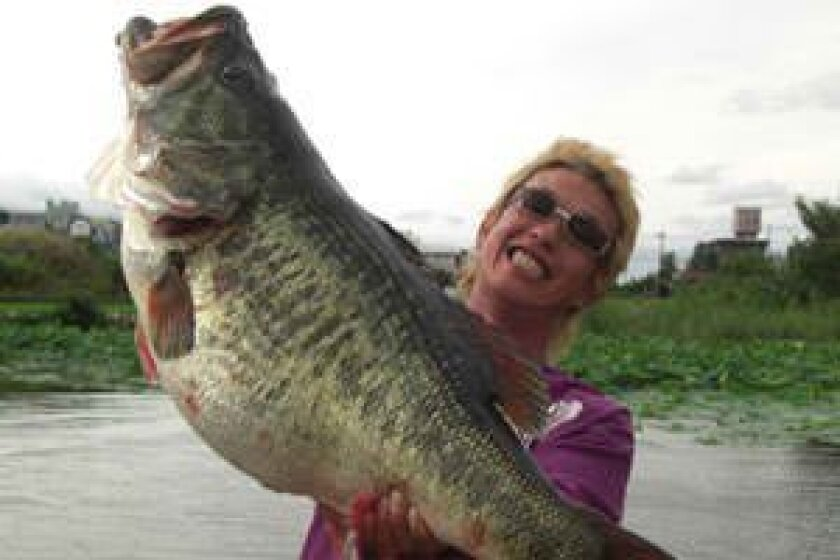 Manabu Kurita of Japan caught this world-record-tying 22-pound, 4.97-ounce largemouth bass in July of 2009 out of Lake Biwa in Japan.