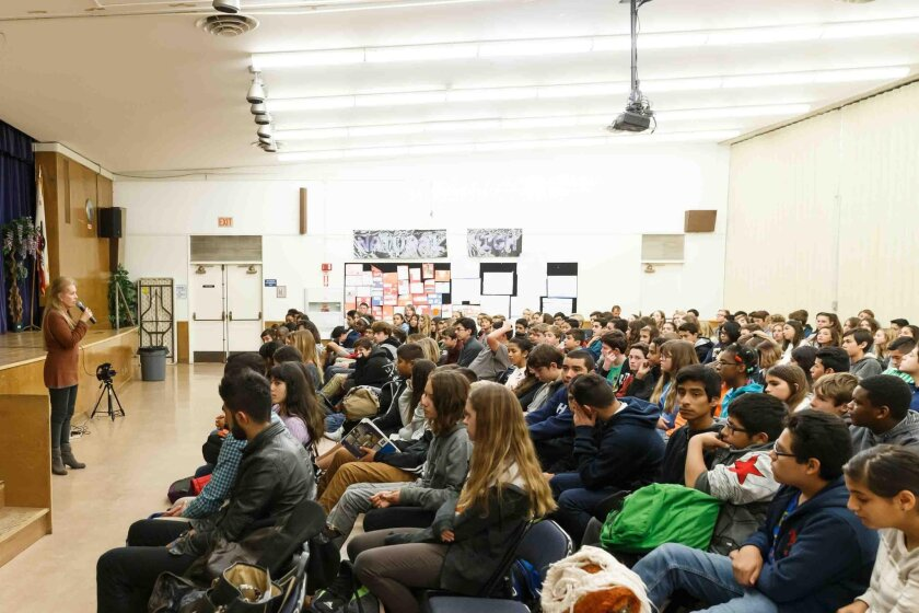 Muirlands Middle School alumna and collaborating author of 'They Poured Fire On Us From the Sky,' Judy Bernstein, speaks with students about refugees' plights during the Sudan civil war, which began in 1987.
