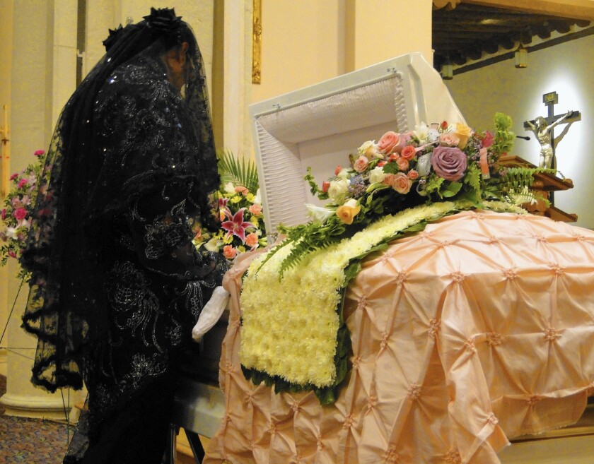 Paul Valdez wore a black dress that he made to his grandmother's funeral. He knew it would cause a stir, but he kept secret his reason for wearing the dress