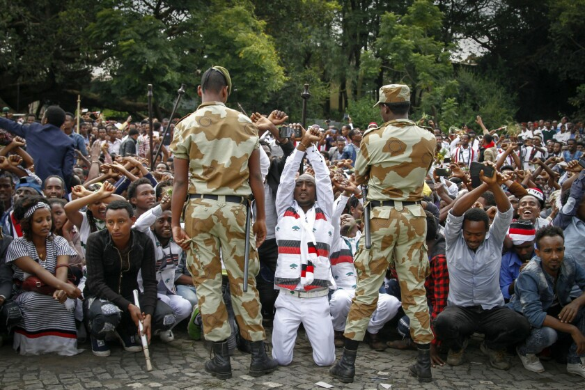 Ethiopian soldiers try to stop protesters in Bishoftu, in the Oromia region.