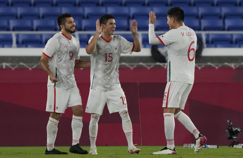 Mexican soccer players Uriel Antuna, Henry Martin and Vladimir Loroña celebrate at the Tokyo Olympics.
