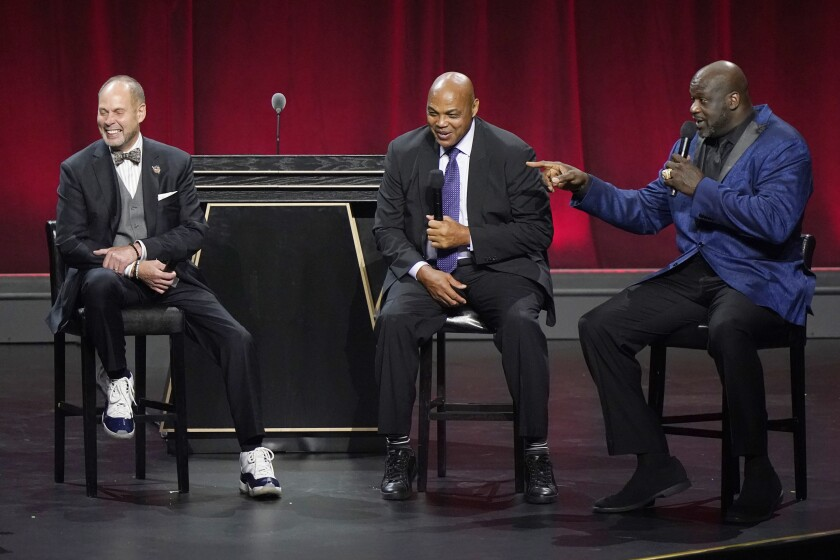 """Broadcasters Ernest Johnson Jr., Charles Barkley, and Shaquille O'Neal, from left, of """"Inside the NBA,"""" smile as they are honored at the 2020 Basketball Hall of Fame awards tip-off celebration and awards gala, Friday, May 14, 2021, in Uncasville, Conn. (AP Photo/Kathy Willens)"""