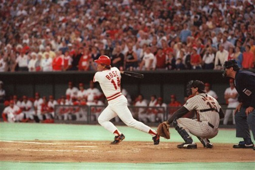 In this Sept. 11, 1985 file photo, Cincinnati Reds baseball player Pete Rose hits a line drive to break Ty Cobb's all-time hit record, in Cincinnati against the Padres. The Padres catcher is Bruce Bochy. (AP Photo/File)