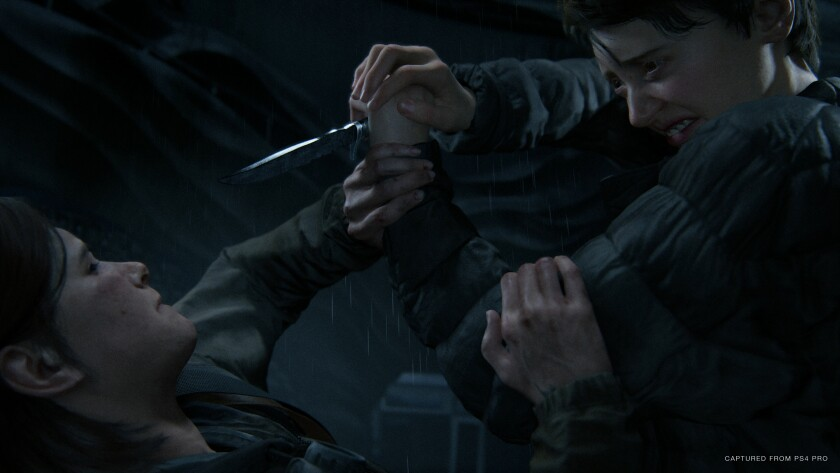 """The Last of Us Part II"" does not hold back in showing difficult moments. Ellie, above, in a fight with Mel."
