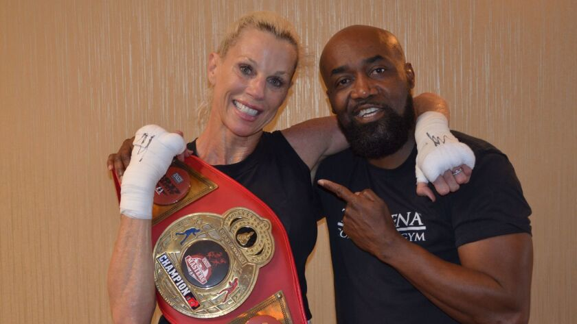 Freiman and her coach Basheer Abdhullah pose with her Title Belt.