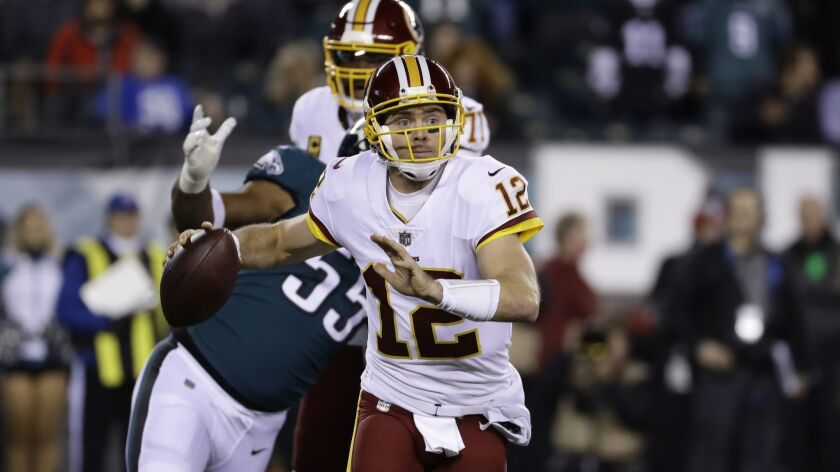 Washington Redskins' Colt McCoy in action during the first half of an NFL football game against the