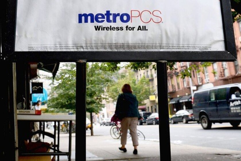 A merger of T-Mobile and MetroPCS would create a company with about 42.5 million subscribers and $24.8 billion in annual revenue. Above, a MetroPCS store in New York.