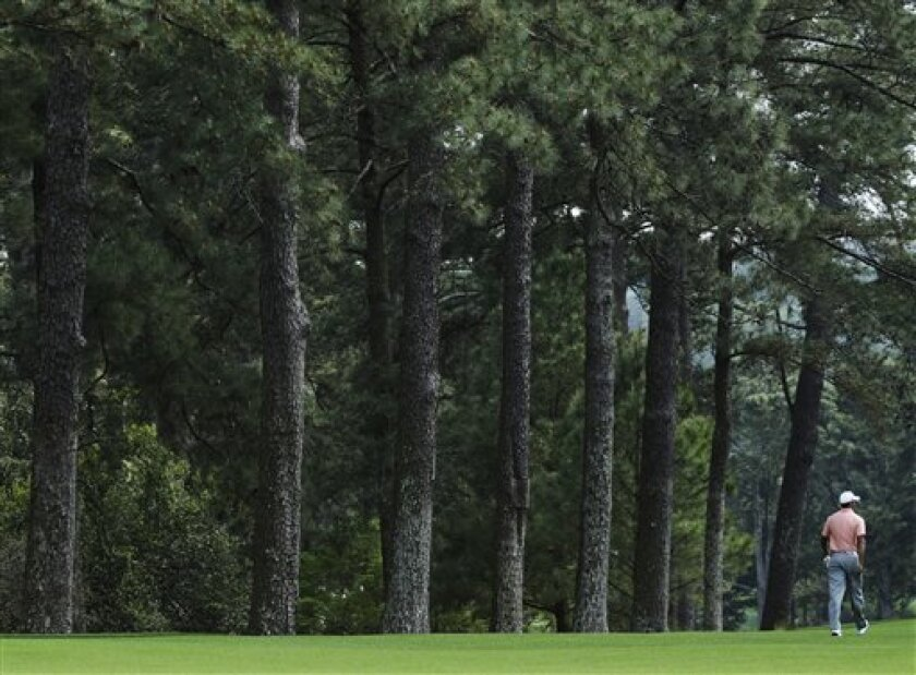 Tiger Woods walks down the second fairway during a practice round for the Masters golf tournament Tuesday, April 9, 2013, in Augusta, Ga. (AP Photo/Matt Slocum)