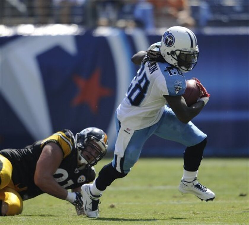 FILE - This Sept. 19, 2010, file photo shows Tennessee Titans running back Chris Johnson (28) getting past Pittsburgh Steelers defensive end Aaron Smith (91) in the third quarter of an NFL football game, in Nashville, Tenn. Figuring out how to stop the Tennessee Titans starts _ and ends _ with Chris Johnson. No NFL defense wants to be beaten by the last man to run for 2,000 yards in a season. (AP Photo/John Russell, File)