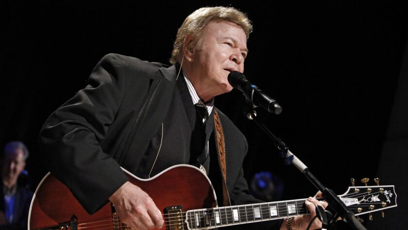 Roy Clark performs after being inducted into the Country Music Hall of Fame in Nashville on May 17, 2009.