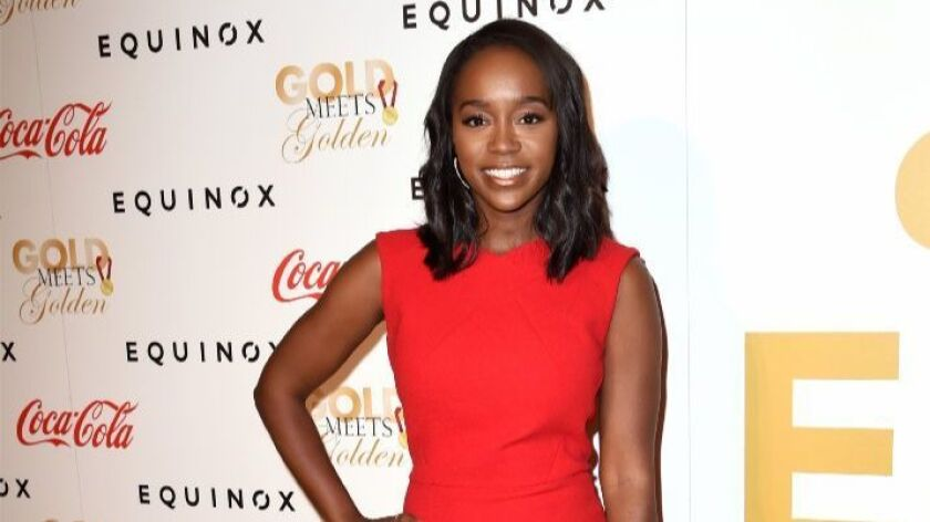 Actress Aja Naomi King poses on the red carpet at Gold Meets Golden.