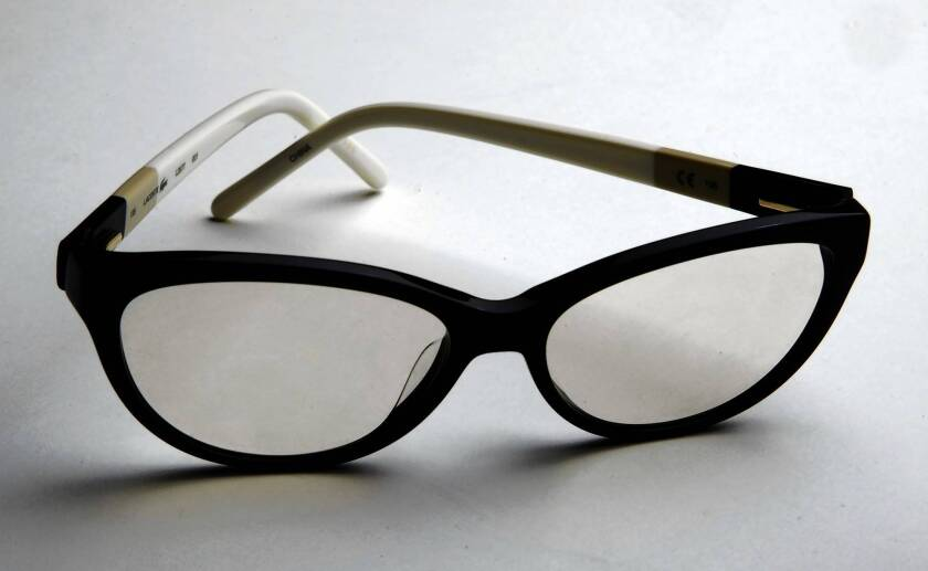 A pair of glasses is fitted with BluTech lenses. The lenses are infused with melanin, a natural pigment found in the iris of the eye, to help filter out high-energy blue light and UVA/UVB radiation.
