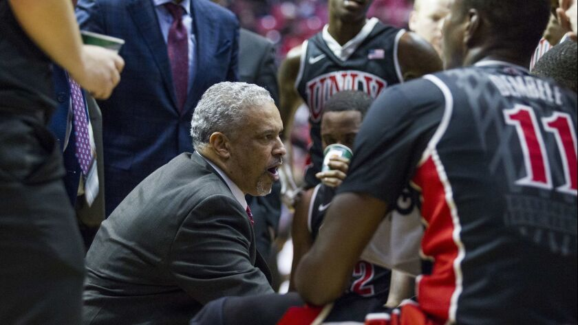 UNLV head coach Marvin Menzies talks to his team during a timeout in a previous game against SDSU at Viejas Arena.