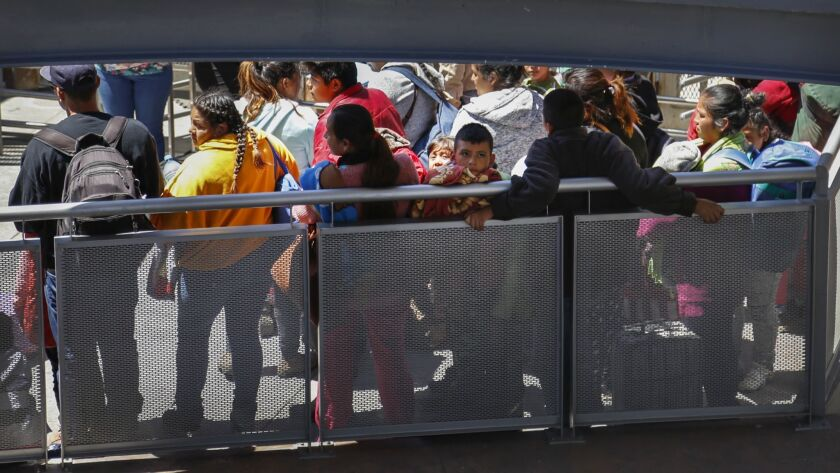 A group of asylum seekers is about to be processed at the San Ysidro port of entry.