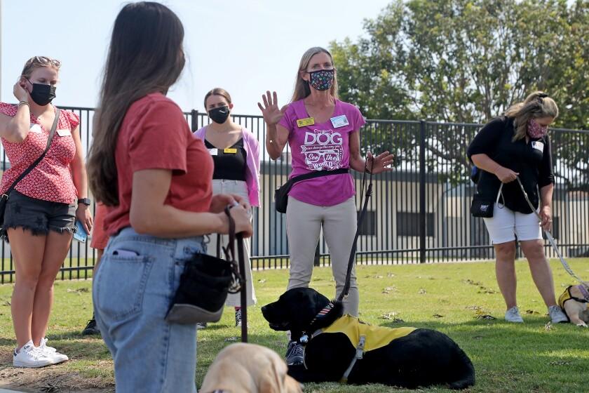 Fourth-grade teacher Holly Sjogren, center, speaks to Guide Dogs of America handlers.