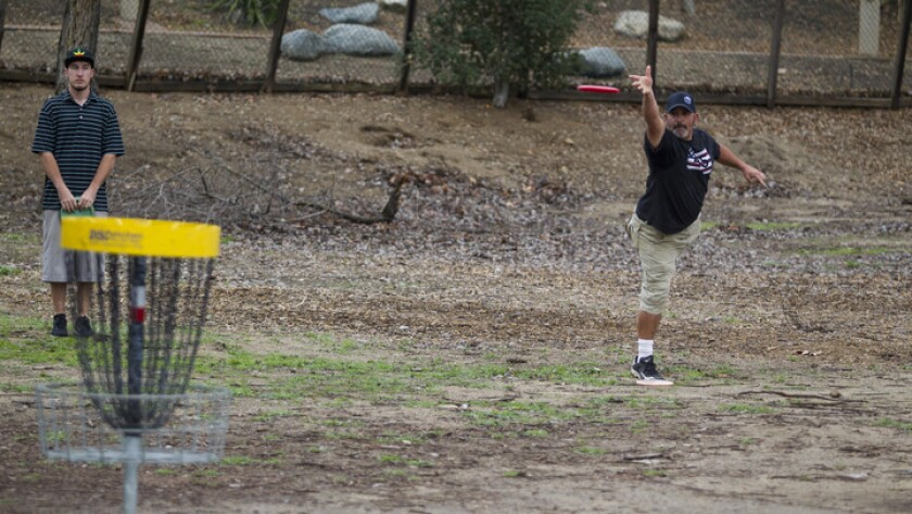 Jerry Jones putts on the fifth hole at Mast Park's disc golf course.