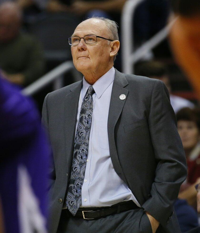 Sacramento Kings head coach George Karl watches during the first half of an NBA basketball game against the Phoenix Suns, Wednesday, Nov. 4, 2015, in Phoenix. (AP Photo/Matt York)