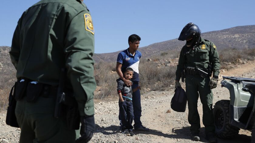 A Guatemalan father and son, who crossed the U.S.-Mexico border illegally, are apprehended by U.S. B