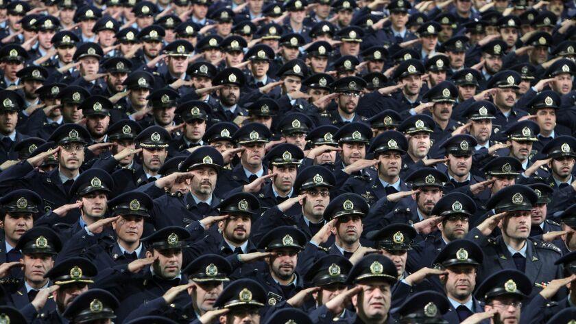 Iranian army air force members salute the country's supreme leader, Ayatollah Ali Khamenei, at a meeting in Tehran in 2013.