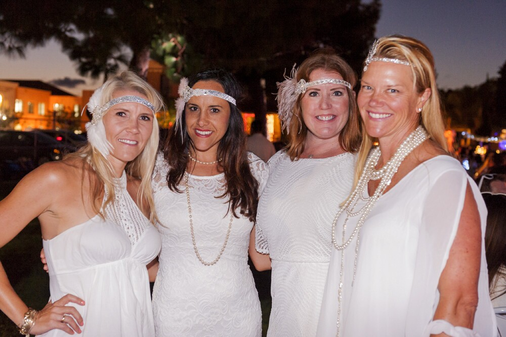 Dressed in all white with white chairs and linens, diners enjoyed an al fresco dinner at Liberty Station for Diner en Blanc on Thursday, Sept. 14, 2017. (Jared Gase)