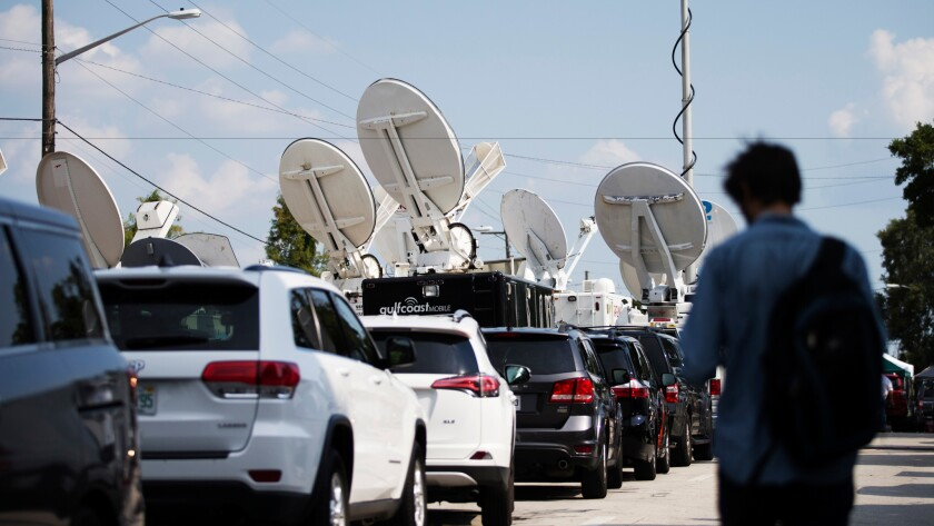Television news trucks are lined up near the scene of the mass shooting at the Pulse nightclub in Orlando, Fla., on June 13.