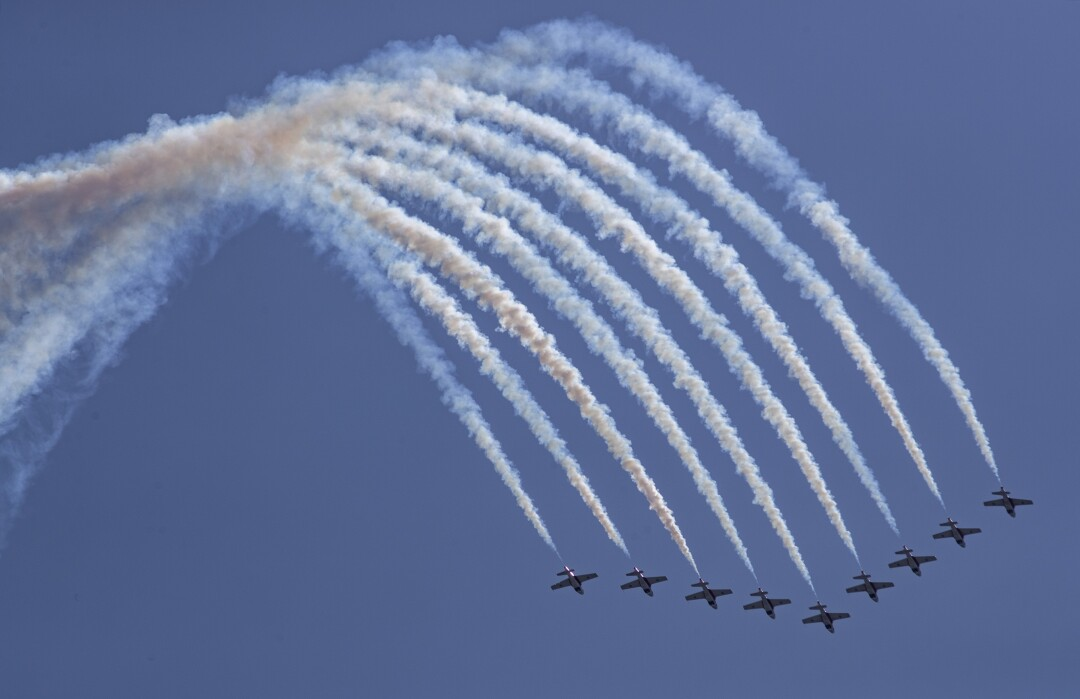 Canadian Forces Snowbirds fly in formation over the ocean