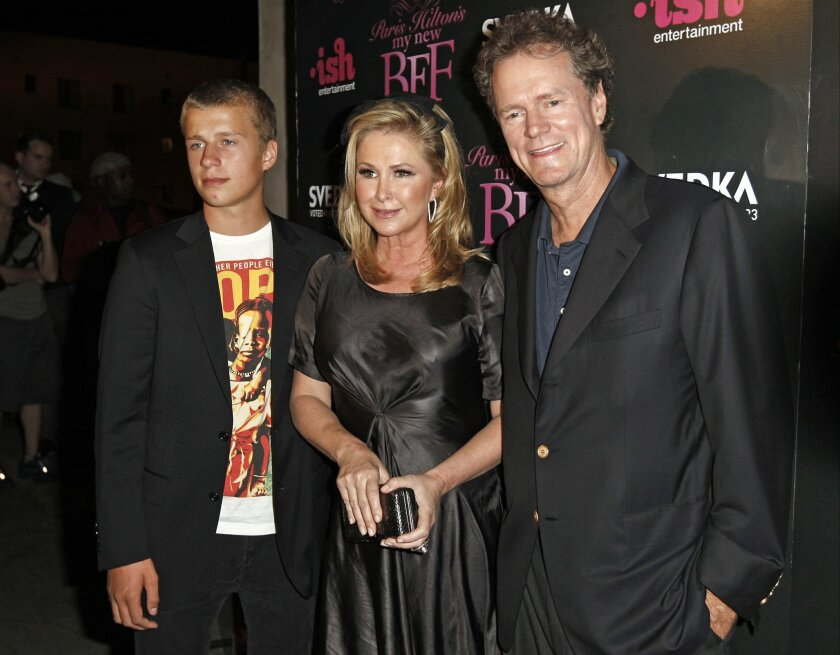 "FILE - In this Sept. 30, 2008, file photo, Conrad Hilton, left, Kathy Hilton, center, and Rick Hilton arrive at the launch party of new MTV series ""Paris Hilton's My New BFF"" in Los Angeles. Police say Conrad Hilton, the younger brother of Paris Hilton, has been ordered into substance abuse treatment after failing drug tests and violating his probation. The 21-year-old was sentenced to probation and community service in 2015 after pleading guilty to disrupting a British Airways flight. A Los Angeles judge on Tuesday, Jan. 26, 2016, ordered Hilton into a residential treatment program for at least 90 days. The judge rejected a request by authorities to put Hilton behind bars for 60 days. (AP Photo/Matt Sayles, File)"